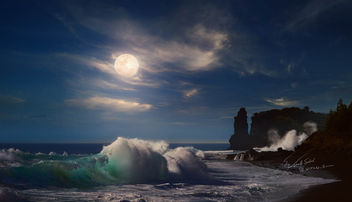 Ocean waves under moonlight at night