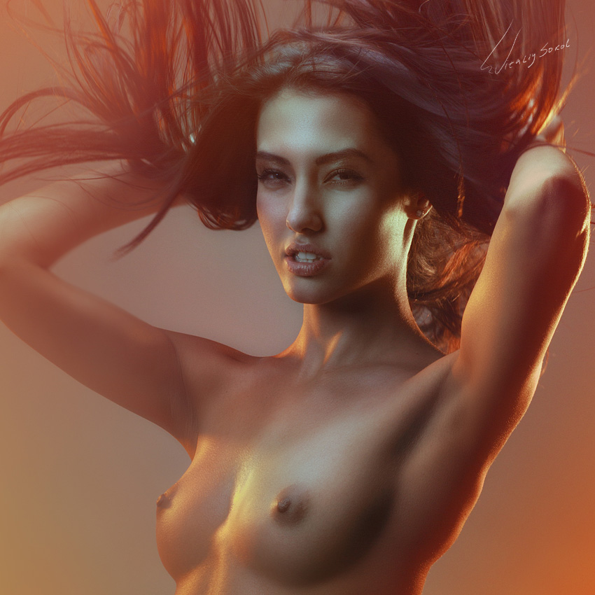 naked beautiful oriental model with streaming hair