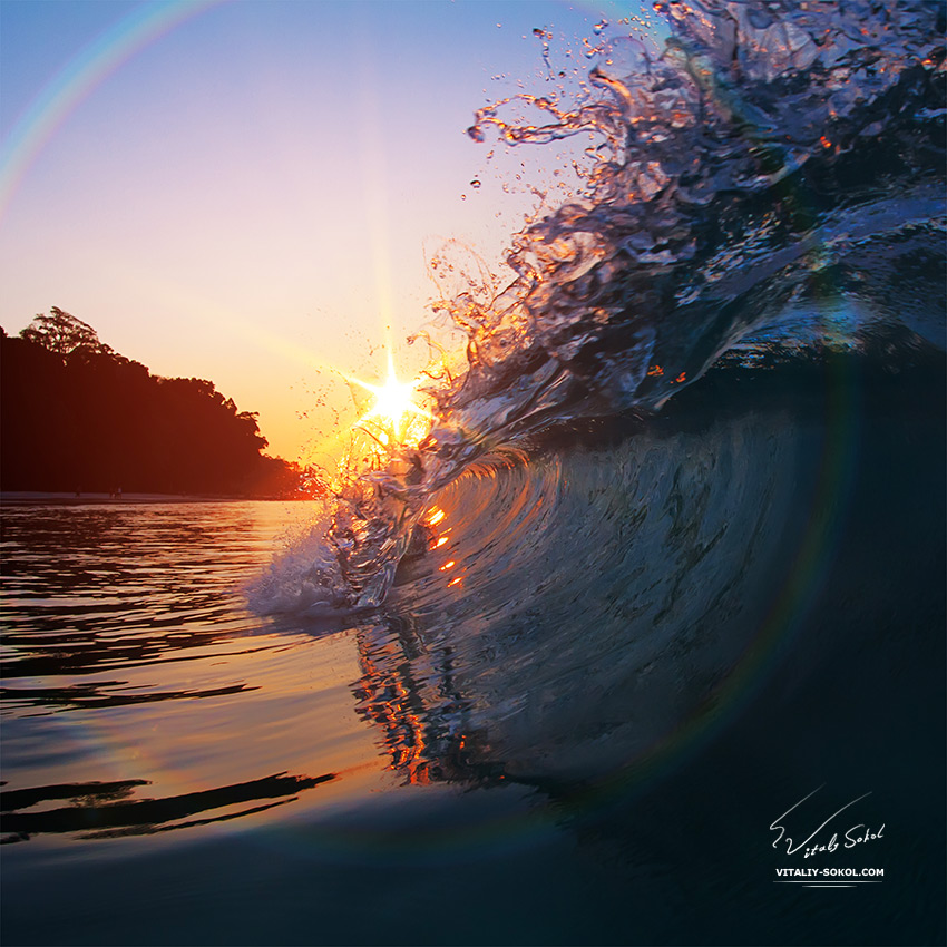 Stock photo: Beautiful sunset and breaking glossy ocean wave<br />
