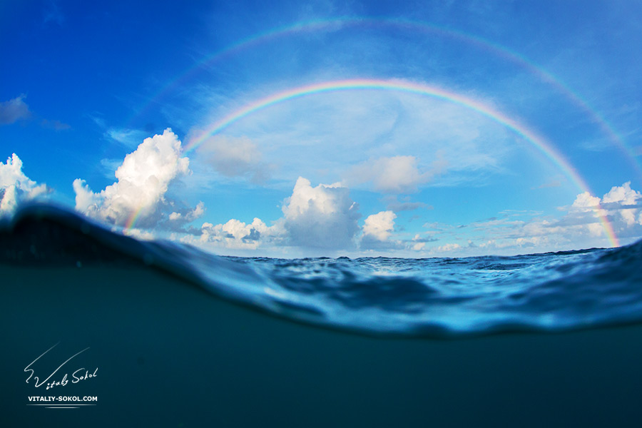 Colorful Beautiful Rainbow over ocean surface