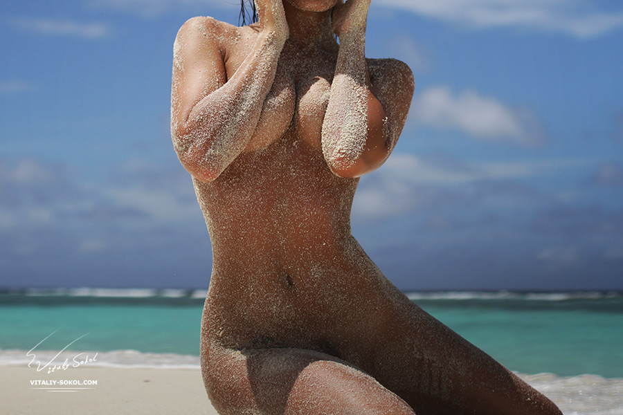 Beautiful naked model on tropical maldivian sandy beach