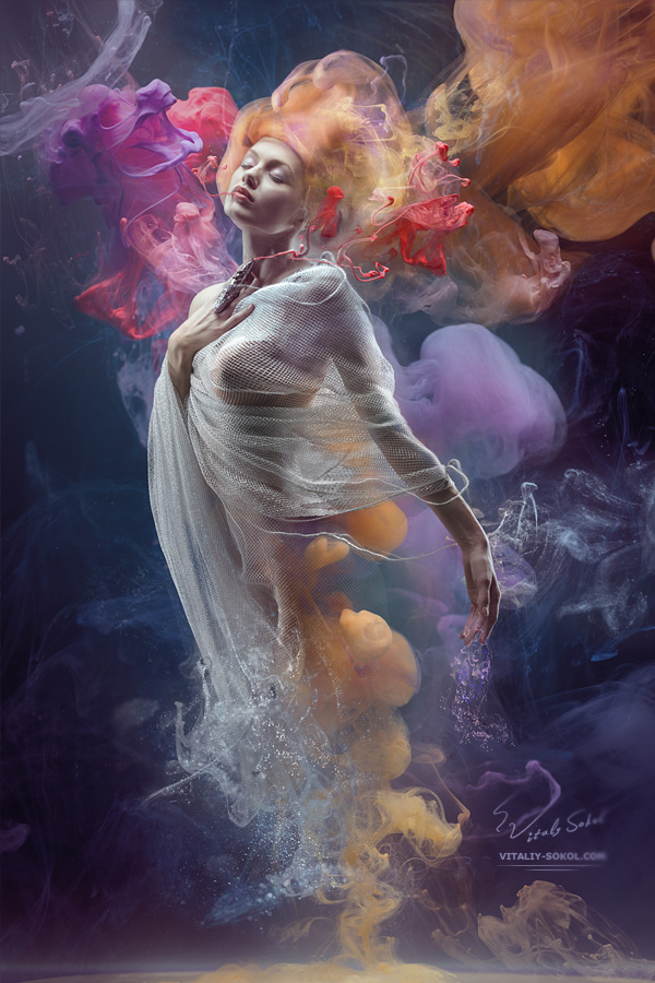 Stock photo: Fantasy fashion model inside colorful clouds. Water paint spreading underwater. Fantastic shapes in deep space. Девушка в окружении облака краски растворённой в воде