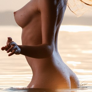 naked model in shining water
