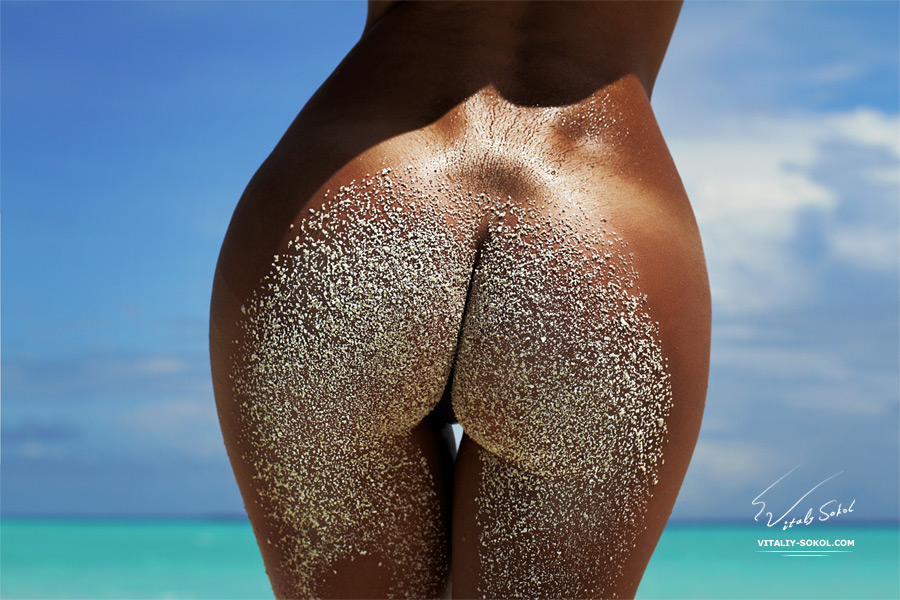 Art Nude model. Ass in sand. Female beautiful buttocks with white sand
