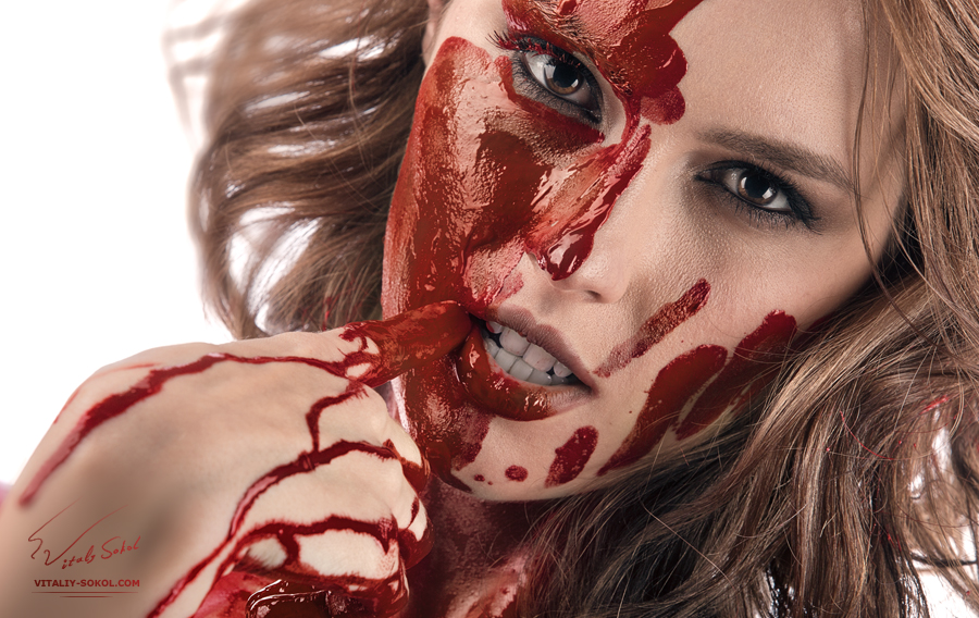 closeup portrait of beauty face in red blood