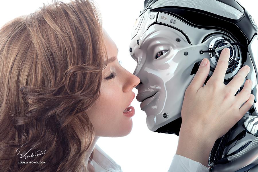 Красивая девушка целуется с роботом. A Beautiful girl kissing with a robot