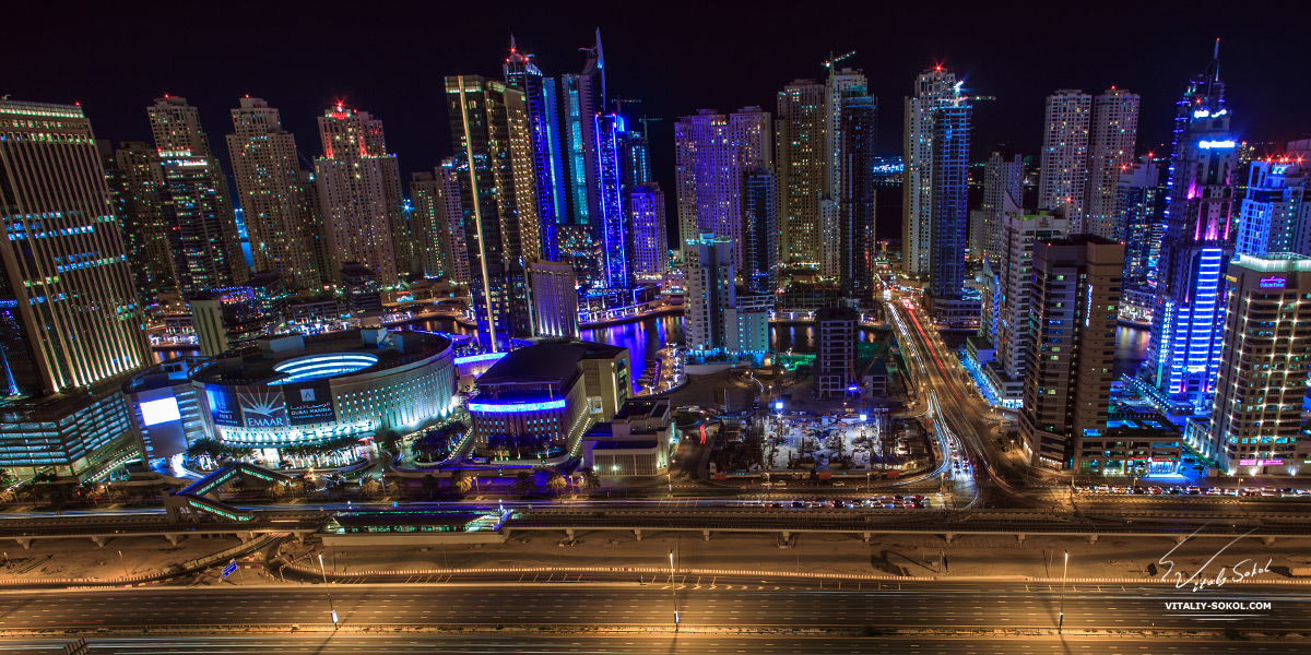 Dubai photos. Night skyscrapers view from roof
