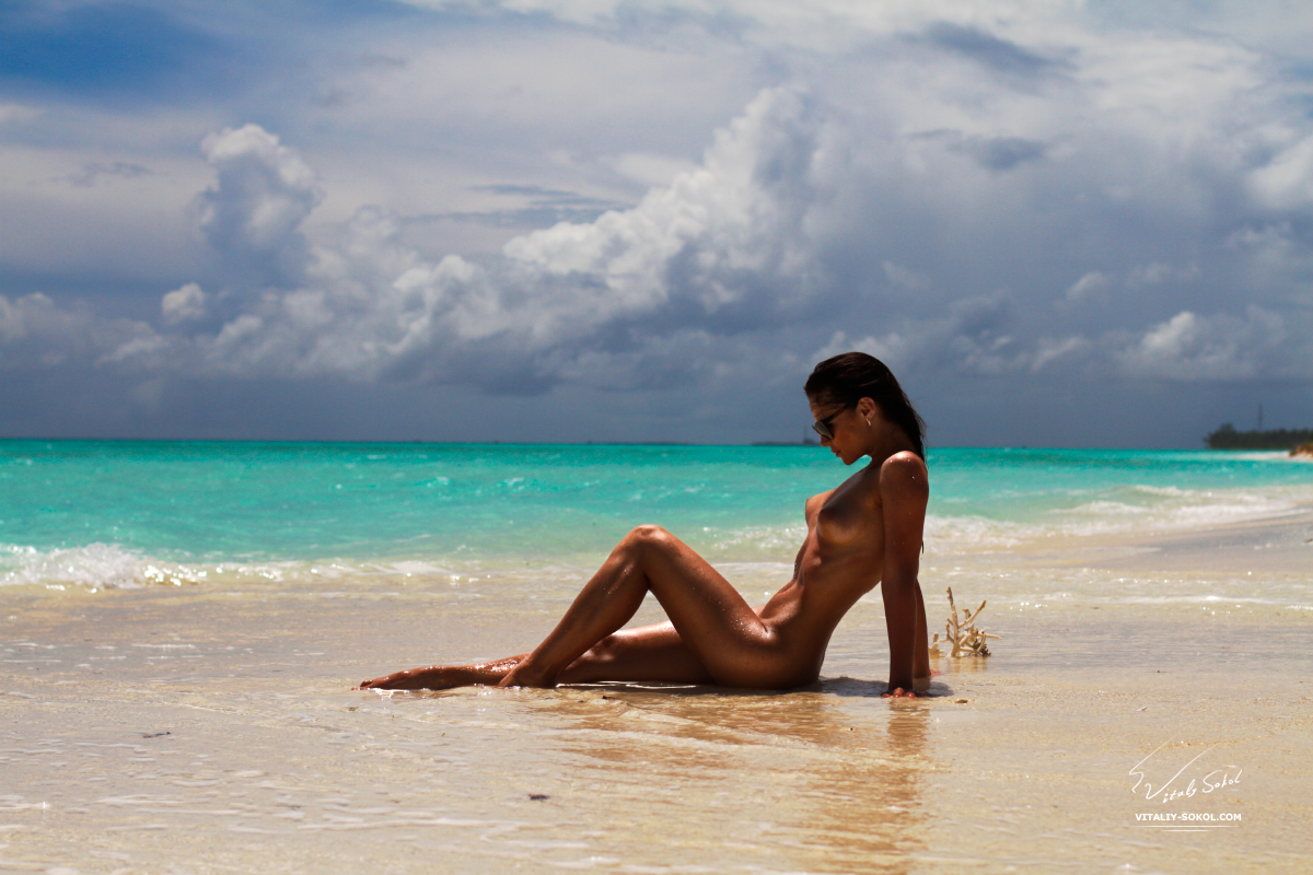 Beautiful Naked Brunete in water at maldivian beach