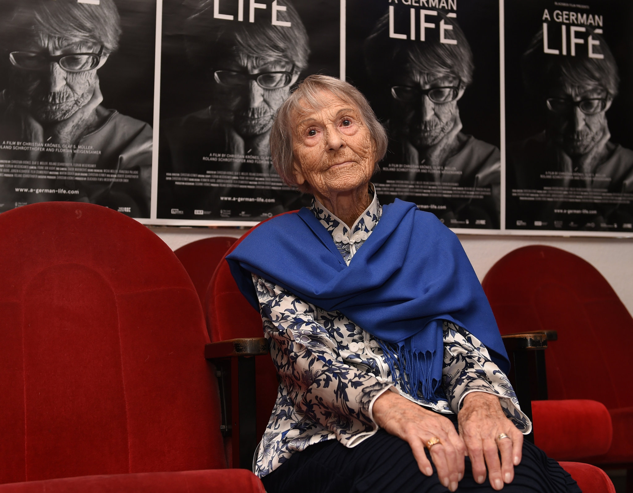 Brunhilde Pomsel in 2016 in front of posters for the documentary A German Life, based on her experiences. Throughout her life, she insisted that she had been ignorant of Nazi atrocities during World War II.