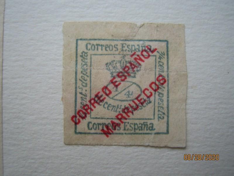Марка 1903 года, «Королевская корона» была выпущена для испанского почтового отделения в Марокко, на марке Испании 1900 года надпечатка «CORREO ESPAGNOL MARRUECOS» Mi:ES-M 4, Sn:ES-MA 1, Sg:ES-MA 2, Edi:ES-MA 1a, номинал — ¼ Spanish céntimo,