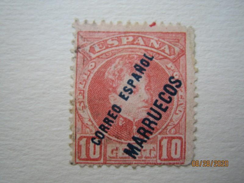 """Марки Испании 1903 года с надпечаткой 'CORREO ESPANOL MARRUECOS' (Король Альфонсо XIII)  синий отпечаток оборотный контрольный номер, начинающийся с A, номиналом — 10 Spanish céntimo, """"Надпечатка (марки Испании 1876 г.)"""", Mi:ES-M 8, Sn:ES-MA 4, Yt:ES-MA 4, Sg:ES-MA 5, Edi:ES-MA 4"""