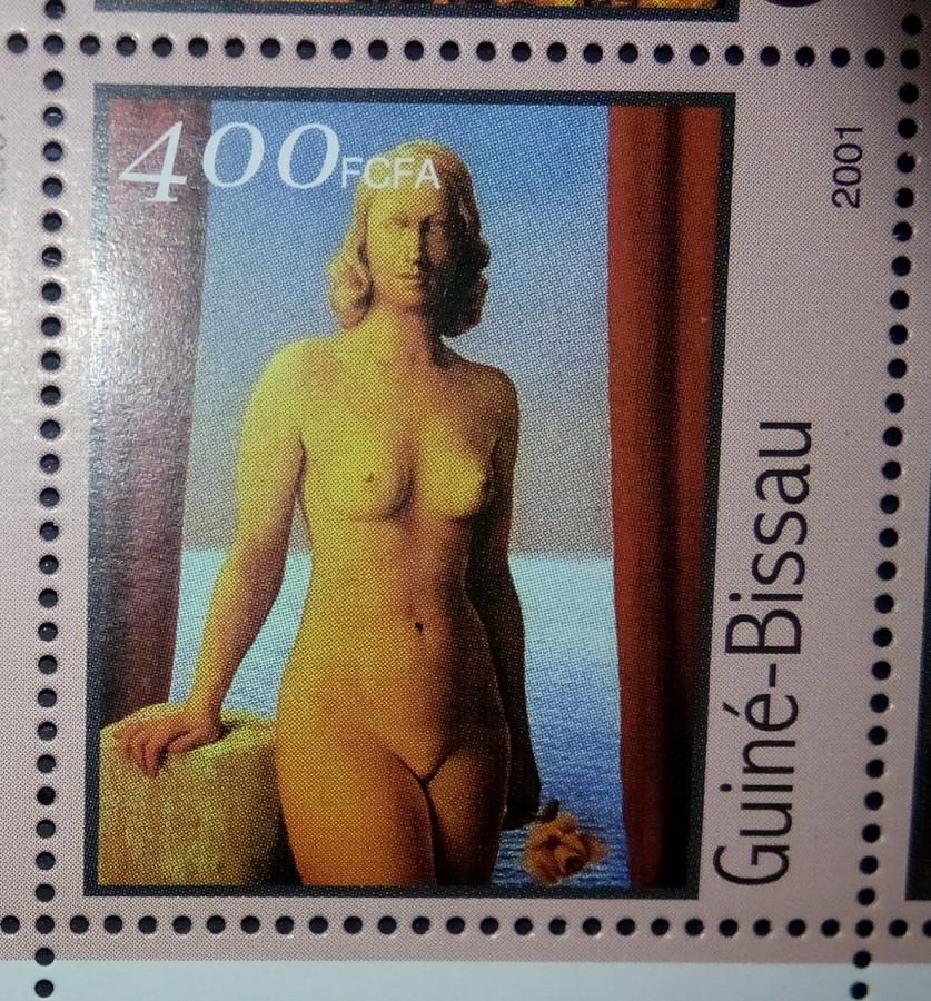 Марка Гвинея-Бисау 2001г., на малом листе «Картины Рене Магритт» на марке номиналом — 400 fr Mi:GW 1688 , репродукция с картины «Цветы зла»
