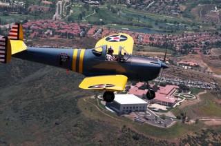 Len Moore flying
