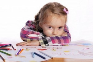14961992-a-tired-child--an-artist-with-a-sketch-and-colored-pencils-in-a-checkered-shirt-on-a-white-backgroun
