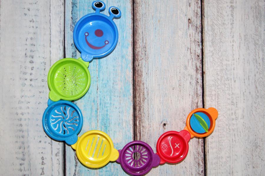 Munchkin, Развивающая игрушка «Гусеница», от 9 месяцев