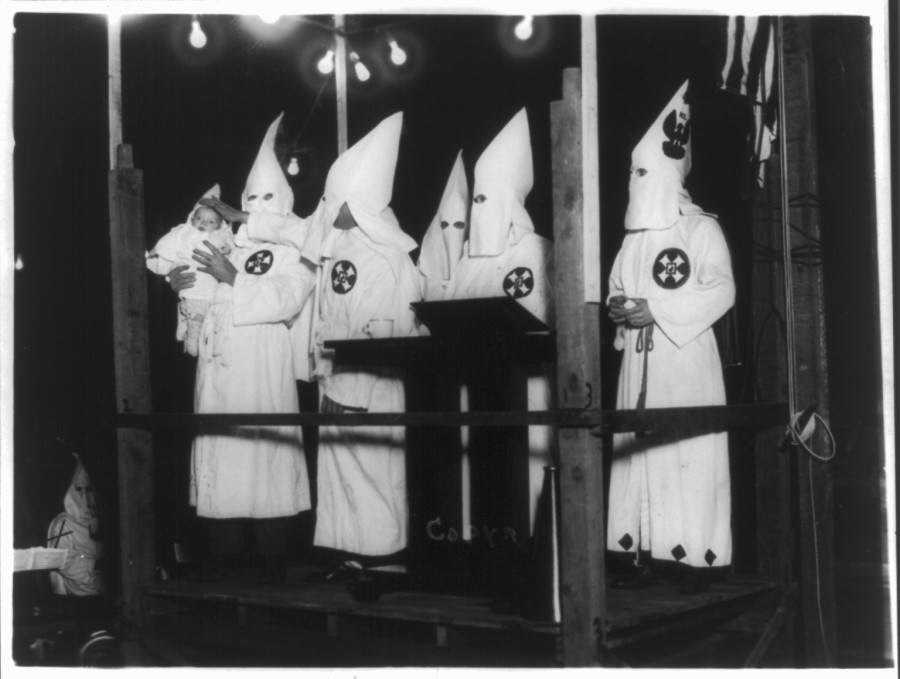 This photo from the Library of Congress collection, location and precise date unknown, does date from the 1920s. The subject here reportedly is the christening of the youngest  Klan member. K