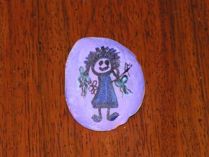 I found this purple rock painted with a girl at Douglas-Hart Nature Center on August 13, 2018.