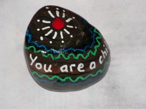 """Here is the top of my rock that says """"You are a child of the universe."""""""