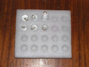 Each crystal has a jump ring through its top hole.