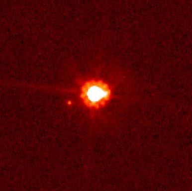 снимок Эриды со спутником с помощью телескопа Хаббл