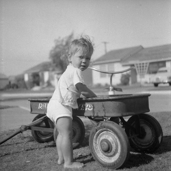 1200px-Radio_flyer_wagon_1950's_and_young_girl